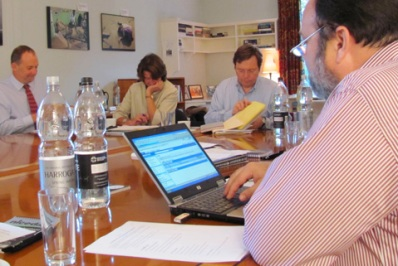 Workshop founder Chuck Lewis reviews his notes at the Oxford symposium.